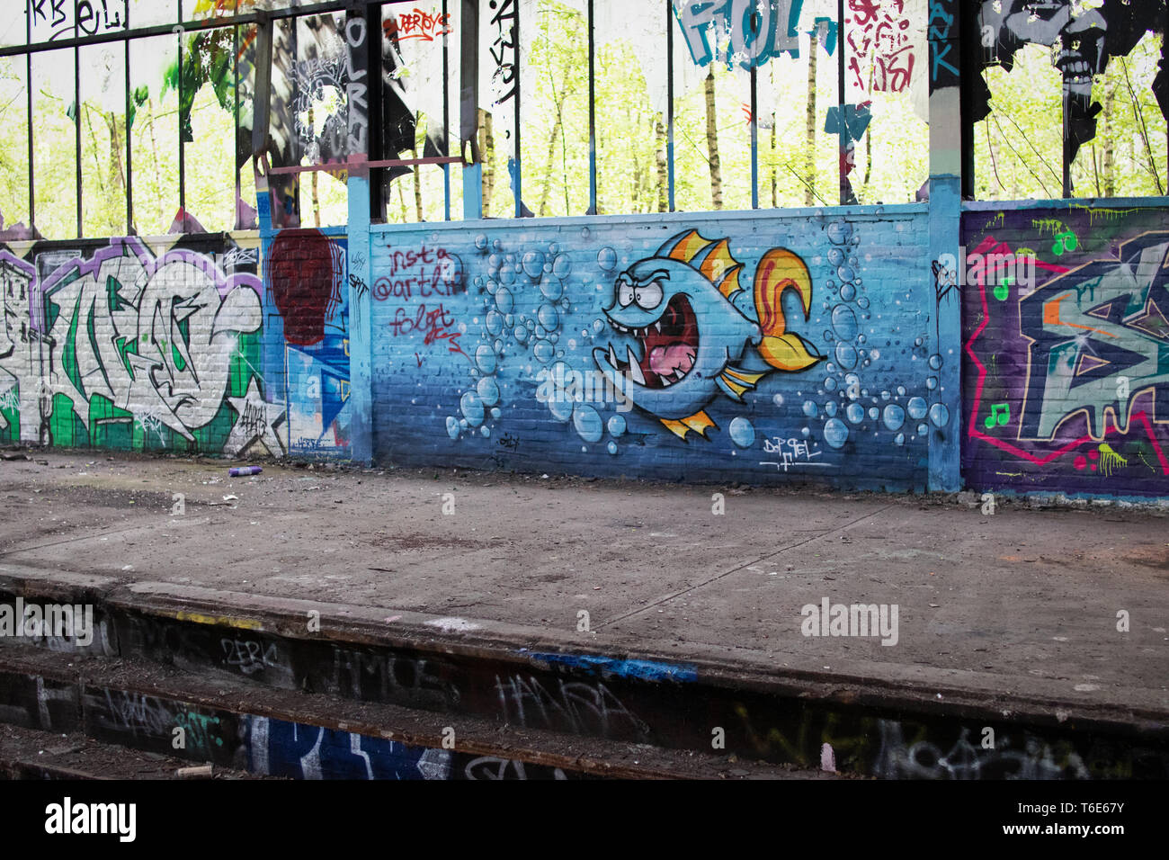 Graffiti Art in a Lost Place in an old train station (Dortmund, Germany) - Stock Image