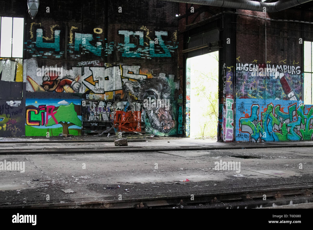 Graffiti wall at an old station in Germany - Stock Image