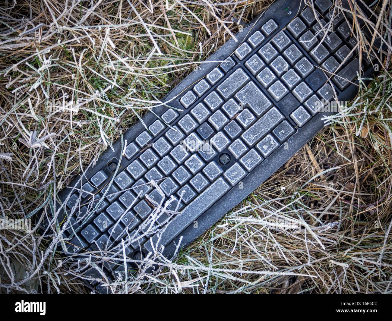 Computer keyboard thrown away - Stock Image