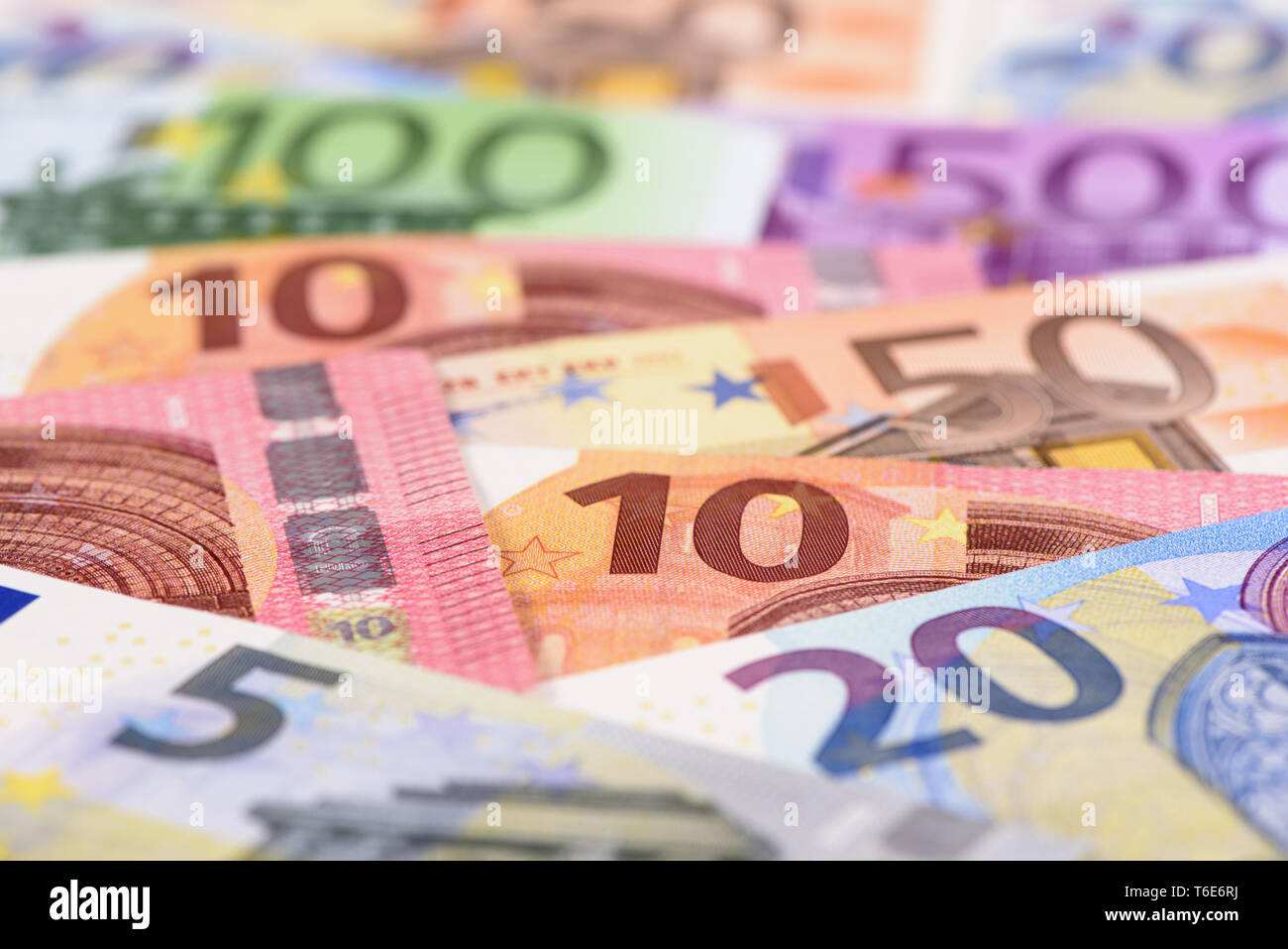 group of many Euro banknotes laying on table Stock Photo