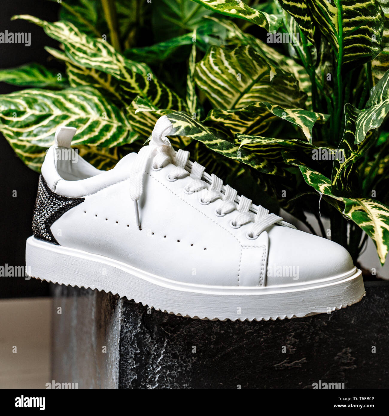 buy popular 6bc56 9cf3e stylish white sneaker with a star ornament made of rhinestones on the  backdrop against the motley