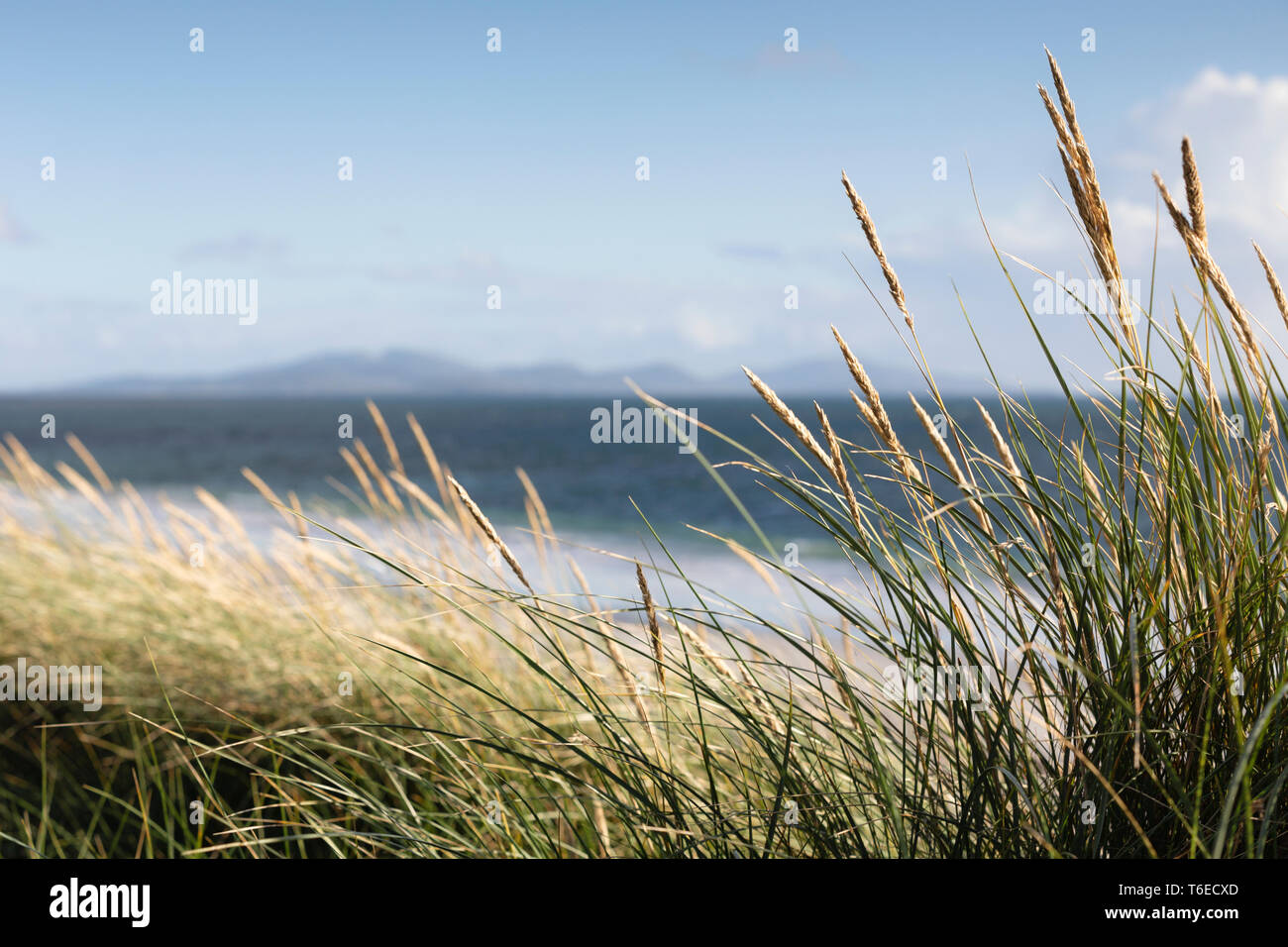 The Isle of Barra viewed from a beach near to Boisdale, Isle of South Uist, Scotland. - Stock Image