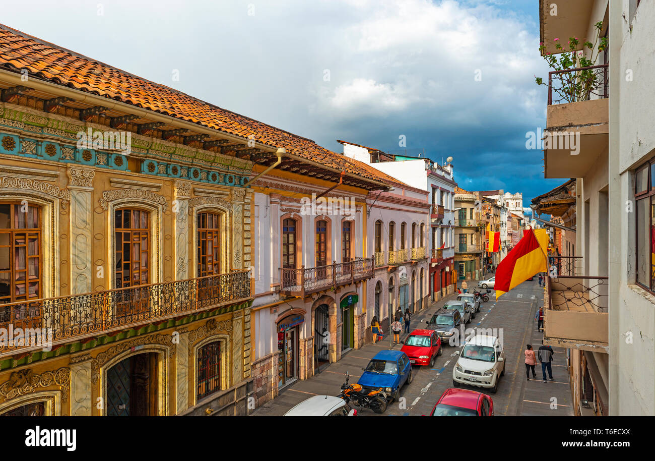 Sunset in the city center of Cuenca with its colonial style facades and a thunder storm on the way, Ecuador. Stock Photo