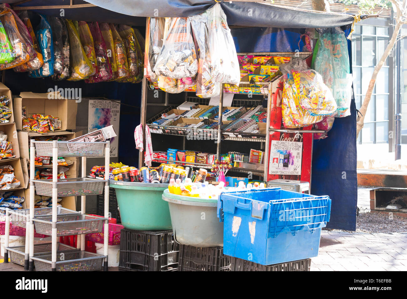 street vendor stall which is very basic in the city centre in Cape Town, South Africa selling refreshments and small items for snacks on the go - Stock Image