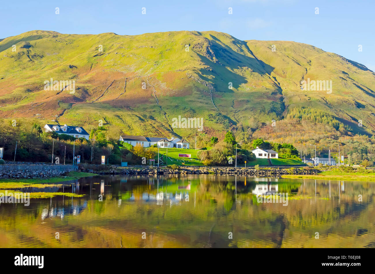 Cottages Beside Killary  Fjord with old potato fields on  the hillside, Connemara Galway, Ireland - Stock Image