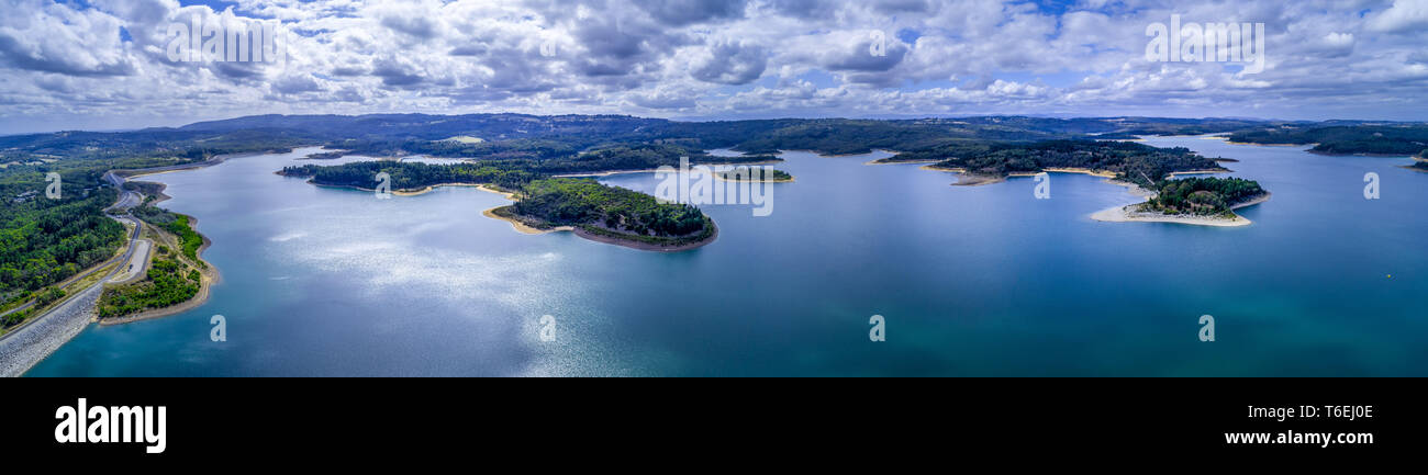 Wide aerial panorama of the scenic Cardinia Reservoir lake and its coastline Stock Photo