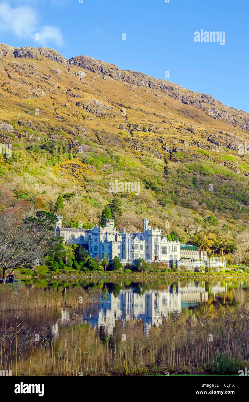 Kylemore Abbey  castle at the base of Druchruach Mountain in Connemara  mountains, Galway,  Ireland - Stock Image