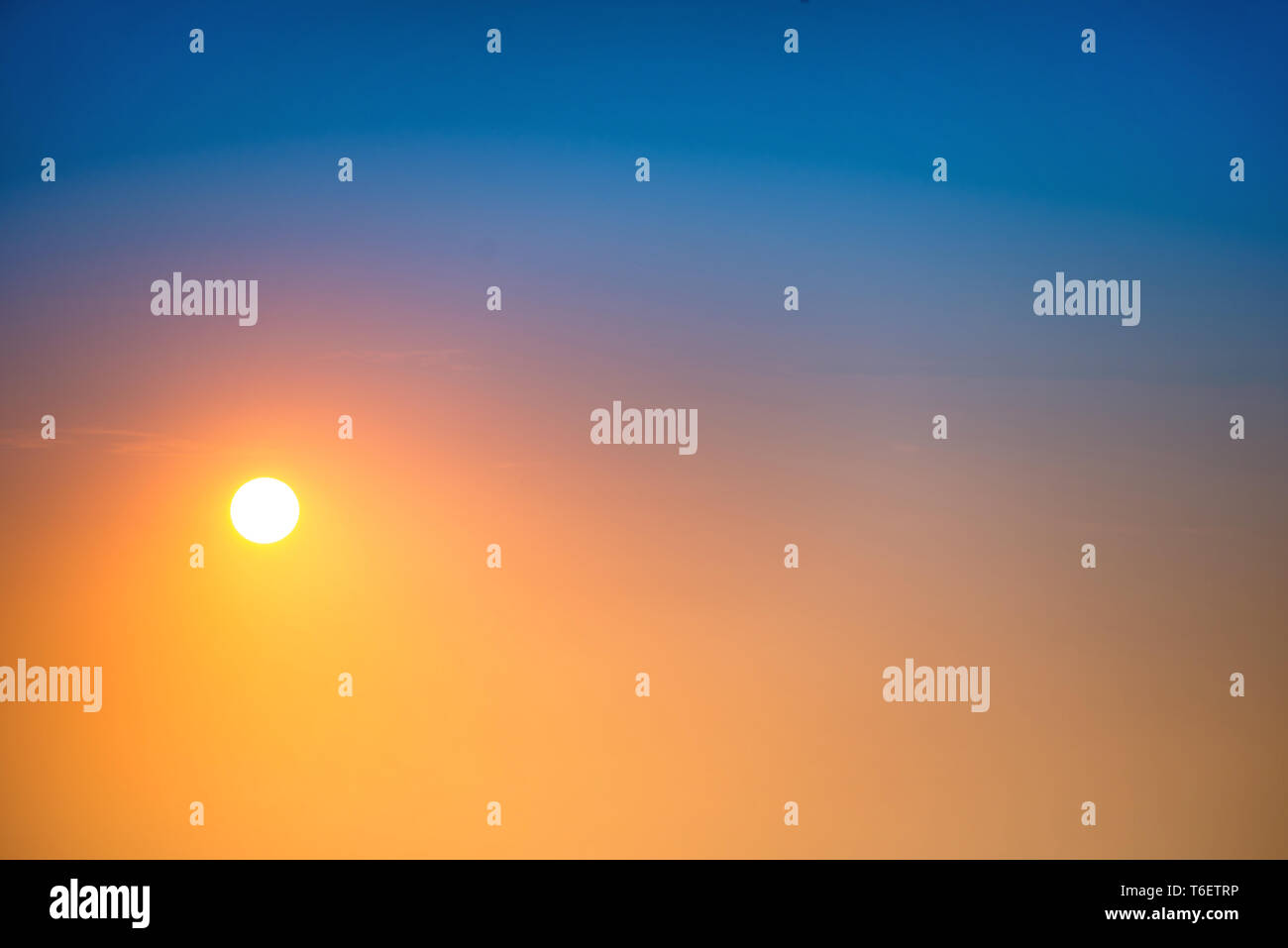 Sunset in the sky with big sun - Stock Image