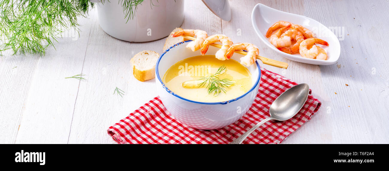rustic asparagus soup with shrimp skew and diel - Stock Image