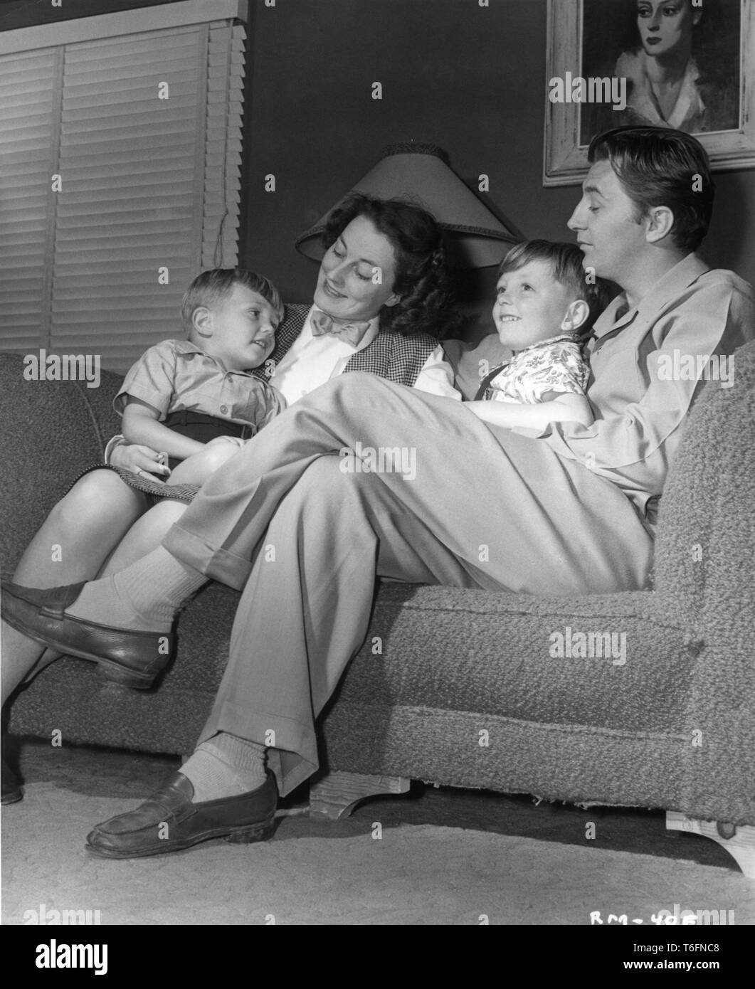 Robert Mitchum At Home With Wife Dorothy And Sons James And Christopher Photo By Ernest A Bachrach 1947 Rko Radio Pictures Inc Stock Photo Alamy