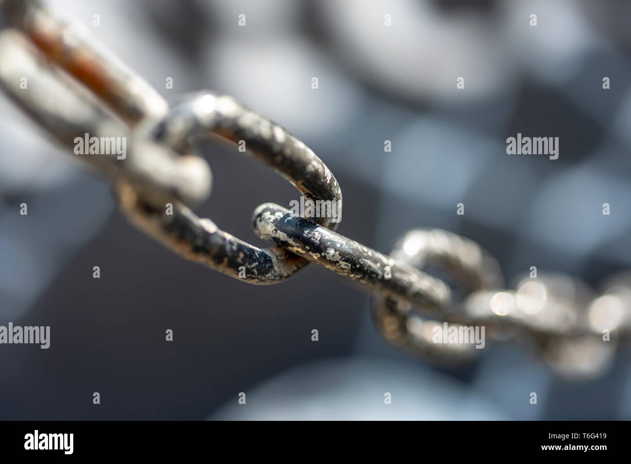 Chain on a blurred background - Stock Image