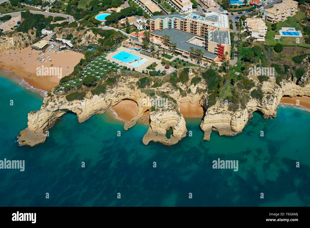 RESORT OVERLOOKING AN IMPRESSIVE LANDSCAPE OF CLIFFS AND COVES (aerial view). Pestana Viking Resort in Porches, Lagoa, Algarve, Portugal. - Stock Image