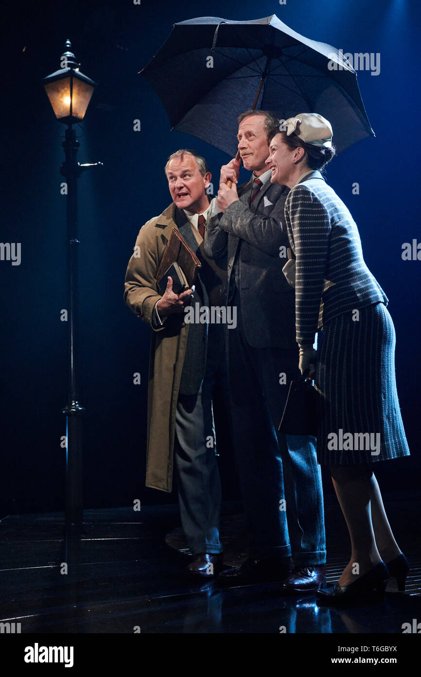 Chichester, UK. 1st May, 2019.  Hugh Bonneville as C.S.Lewis, Andrew Havill as Warnie and Liz White as Joy Gresham in  Shadowlands by William Nicholson at the Chichester Festival Theatre. Credit: Thomas Bowles/Alamy Live News - Stock Image