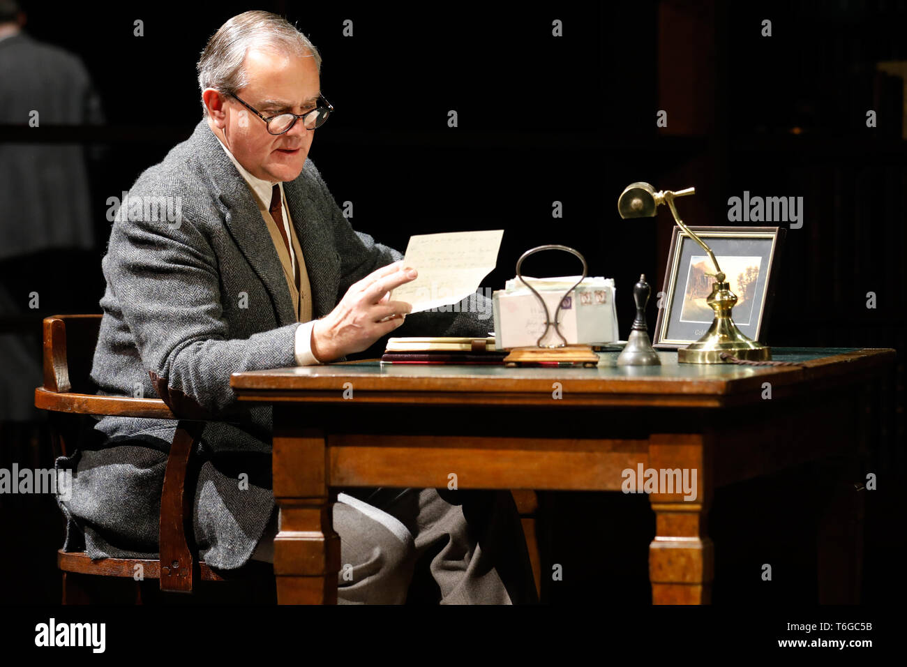 Chichester, UK. 1st May 2019. Hugh Bonneville performs as C.S. Lewis during a photocall for William Nicholson's 'Shadowlands' at the Chichester Festival Theatre in West Sussex, UK Wednesday May, 1, 2019. The play, directed by Rachel Kavanaugh, runs until May 25. Photograph : Credit: Luke MacGregor/Alamy Live News - Stock Image