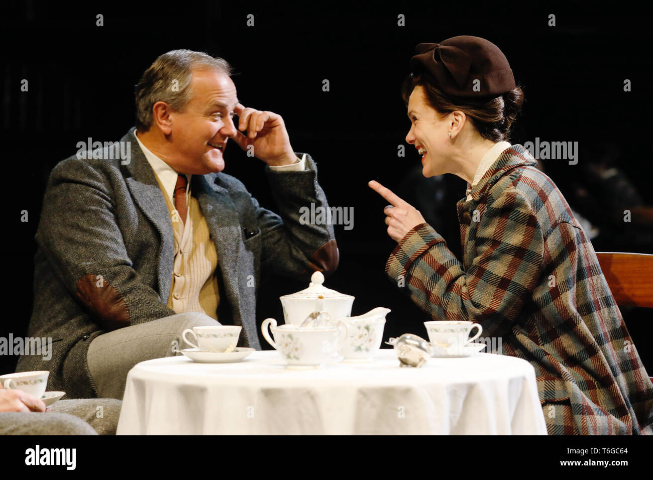 Chichester, UK. 1st May 2019. Hugh Bonneville (L) performs as C.S. Lewis, with Liz White (as Joy Gresham) during a photocall for William Nicholson's 'Shadowlands' at the Chichester Festival Theatre in West Sussex, UK Wednesday May, 1, 2019. The play, directed by Rachel Kavanaugh, runs until May 25. Photograph : Credit: Luke MacGregor/Alamy Live News - Stock Image