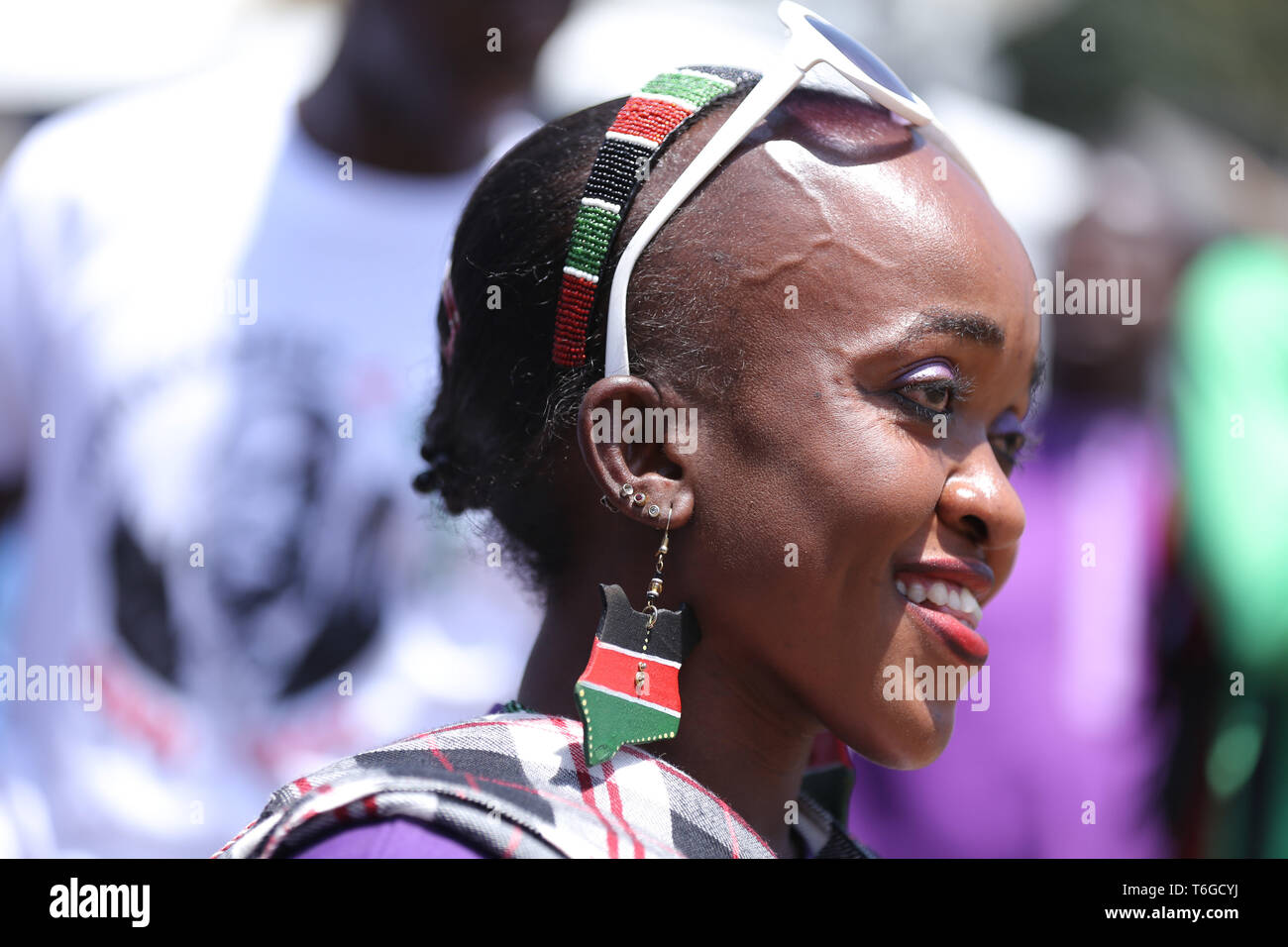 Nairobi, Kenya. 1st May, 2019. Elizabeth Moraa Gabriel, seen dressed in Kenyan flag colours during the celebrations.Kenyans celebrated Labour Day at Uhuru Park in Nairobi where some Youths protested against rampant corruption and poor leadership in Kenya. Unemployment and underemployment is widespread in the country. Credit: Billy Mutai/SOPA Images/ZUMA Wire/Alamy Live News Stock Photo