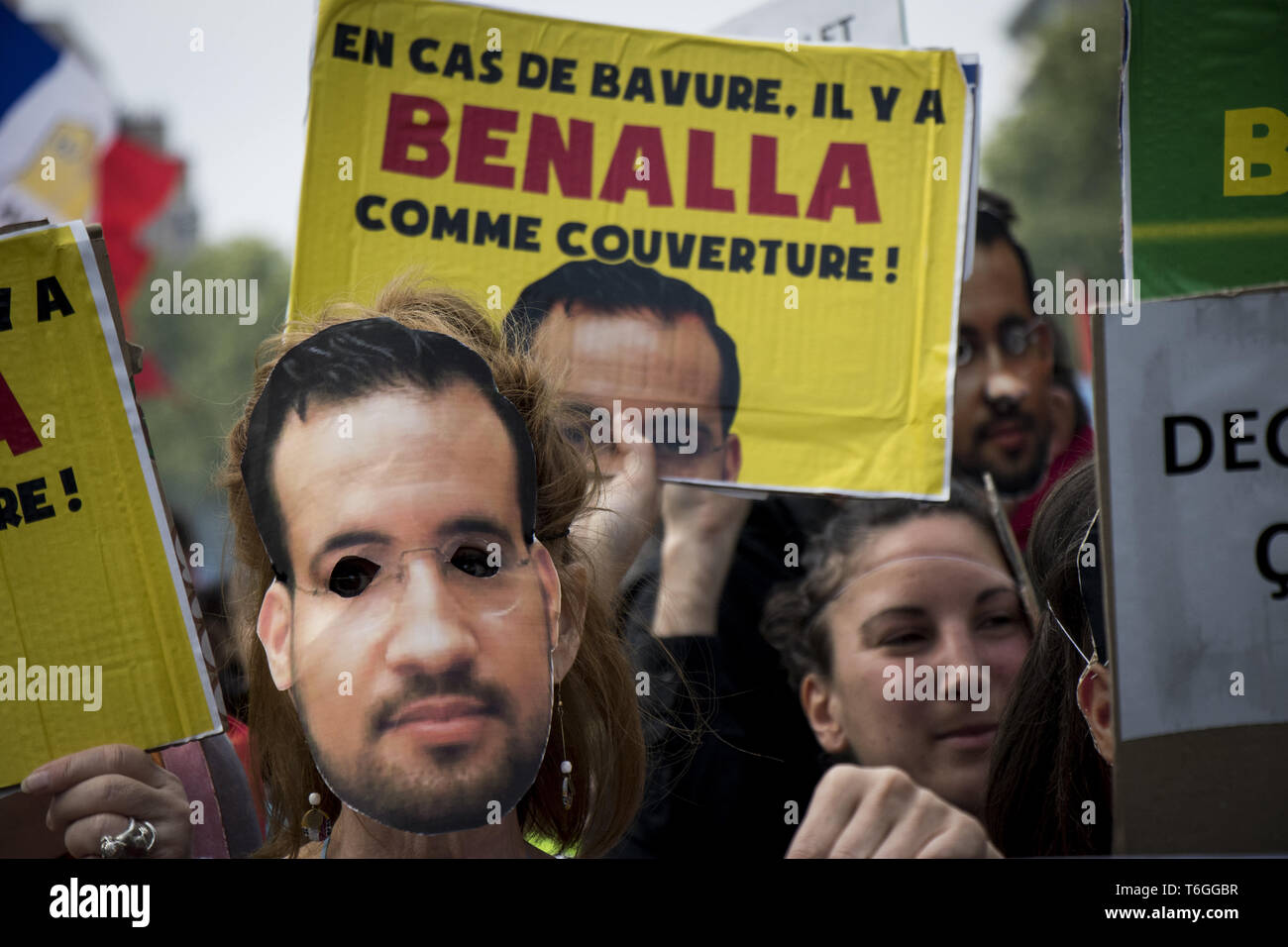 May 1, 2019 - Protesters wearing masks depicting Alexandre Benalla, a French president's former bodyguard had been caught on video roughing up protesters during a May Day rally on the Contrescarpe square in Paris, take part in an event called ''BenallApero'', on May 1, 2019, on the square. Paris riot police fired teargas as they squared off against hardline demonstrators among tens of thousands of May Day protesters, who flooded the city in a test for France's zero-tolerance policy on street violence. (Credit Image: © Elyxandro CegarraZUMA Wire) - Stock Image