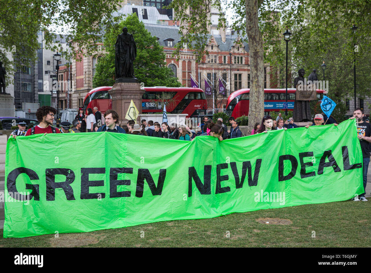 London, UK. 1st May, 2019. A Green New Deal banner among climate protesters attending a Declare A Climate Emergency Now demonstration in Parliament Square organised to coincide with a motion in the House of Commons to declare an environment and climate emergency tabled by Leader of the Opposition Jeremy Corbyn. The motion, which does not legally compel the Government to act, was passed without a vote. Credit: Mark Kerrison/Alamy Live News Stock Photo