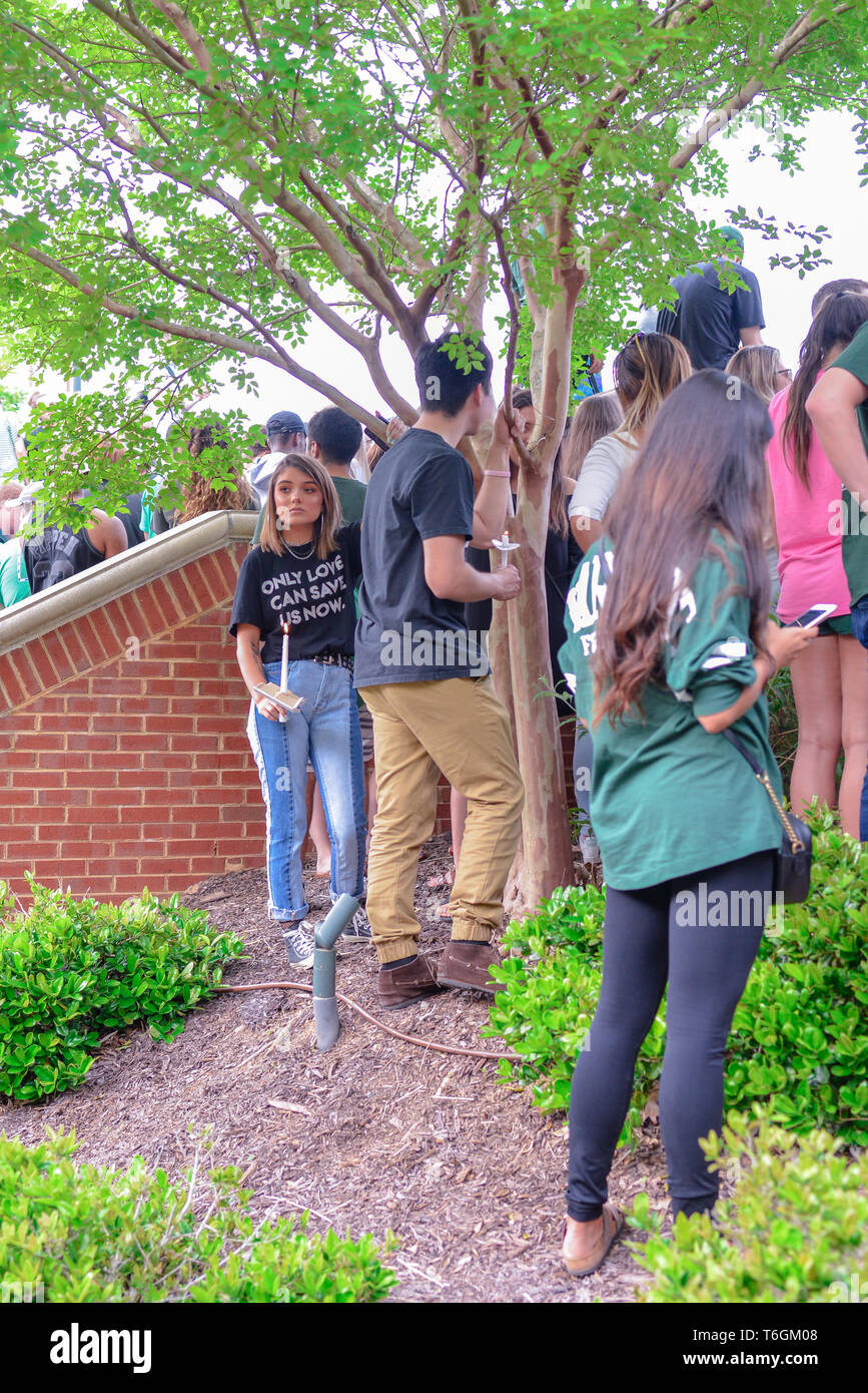 Charlotte, North Carolina, USA. 01st May, 2019. Students, teachers, and community members gather to hold vigil at UNCC. A mass shooting occurred at the university the prior day adding one more school to the list of school shootings in America in the midst of a gun control controversy. Credit: Castle Light Images/Alamy Live News - Stock Image