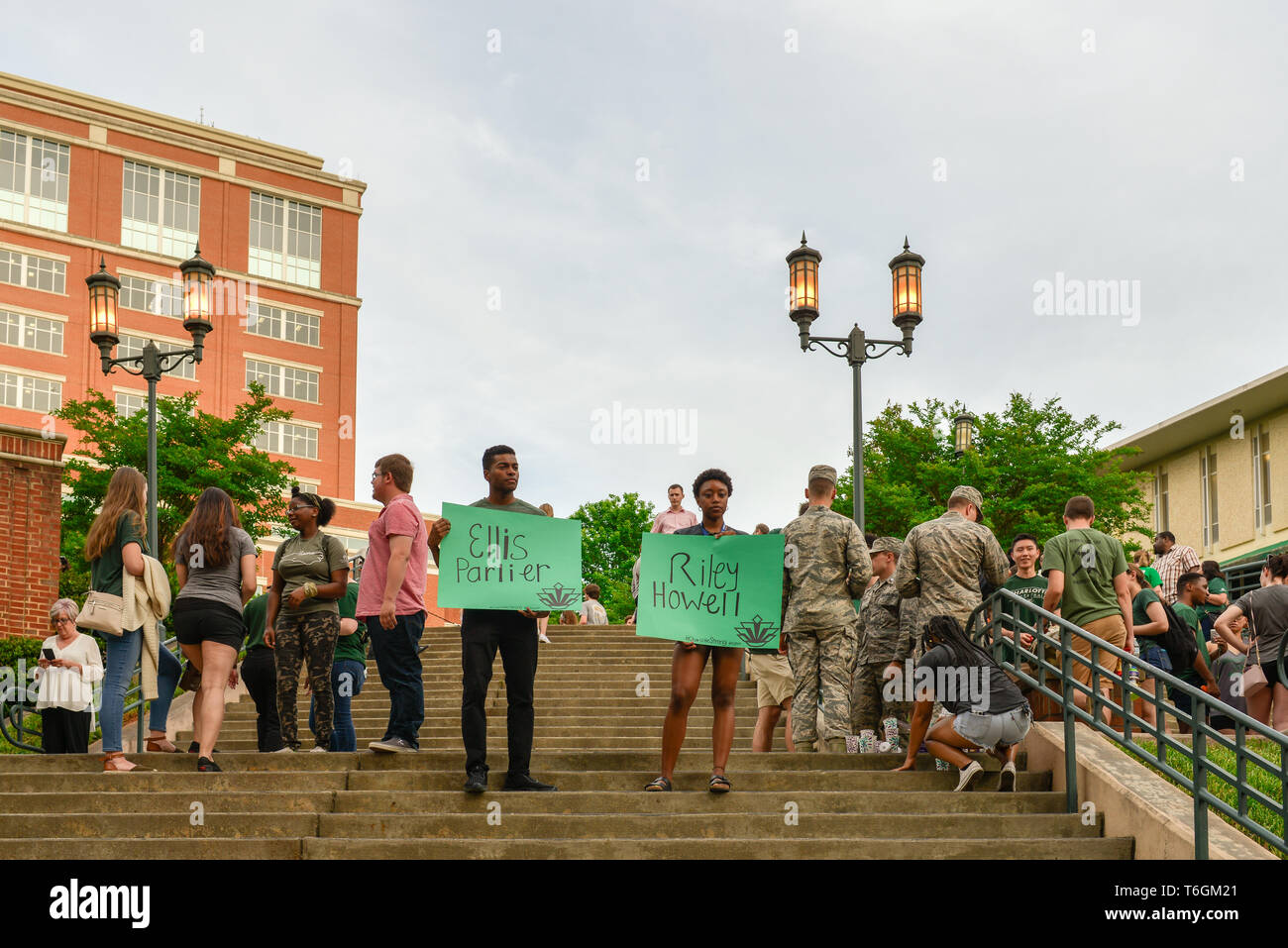 Charlotte, North Carolina, USA. 01st May, 2019. Students, teachers, and community members gather to hold vigil at UNCC including these two who silently stood holding a poster with the name of a deceased peer in their honor. A mass shooting occurred at the university the prior day adding one more school to the list of school shootings in America in the midst of a gun control controversy. Credit: Castle Light Images/Alamy Live News - Stock Image