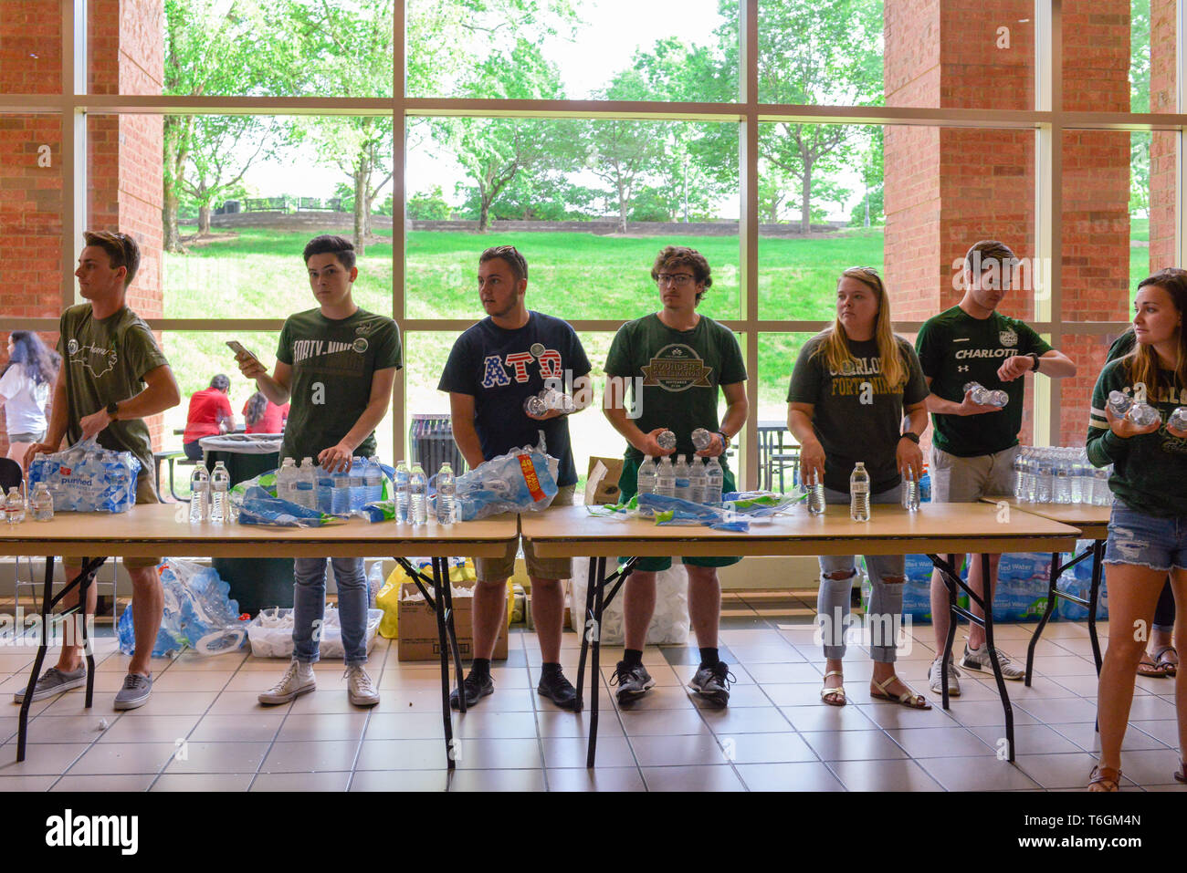 Charlotte, North Carolina, USA. 01st May, 2019. Students, teachers, and community members gather to hold vigil at UNCC including this group handing out water bottles. A mass shooting occurred at the university the prior day adding one more school to the list of school shootings in America in the midst of a gun control controversy. Credit: Castle Light Images/Alamy Live News - Stock Image