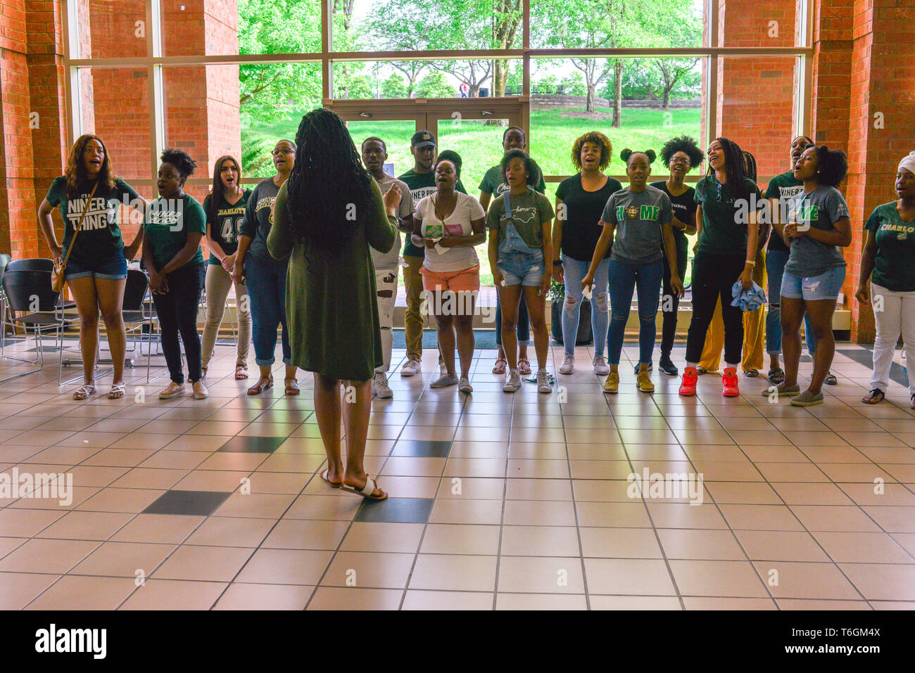 Charlotte, North Carolina, USA. 01st May, 2019. Students, teachers, and community members gather to hold vigil at UNCC including this singing group who provided support before the vigil. A mass shooting occurred at the university the prior day adding one more school to the list of school shootings in America in the midst of a gun control controversy. Credit: Castle Light Images/Alamy Live News - Stock Image