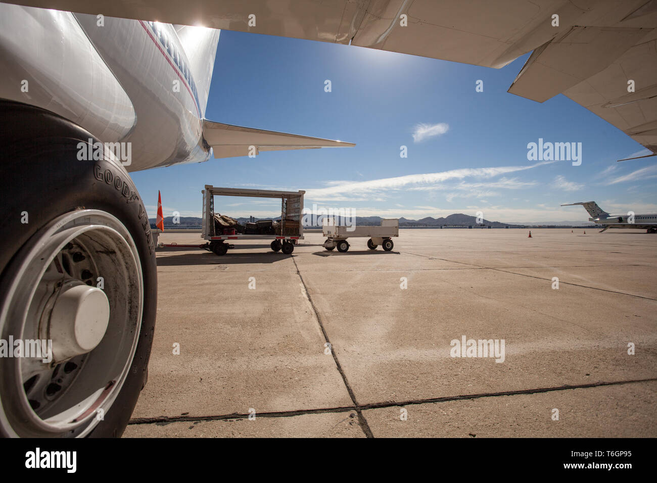 A big civil airplane standing on a tarmac at the airport. - Stock Image