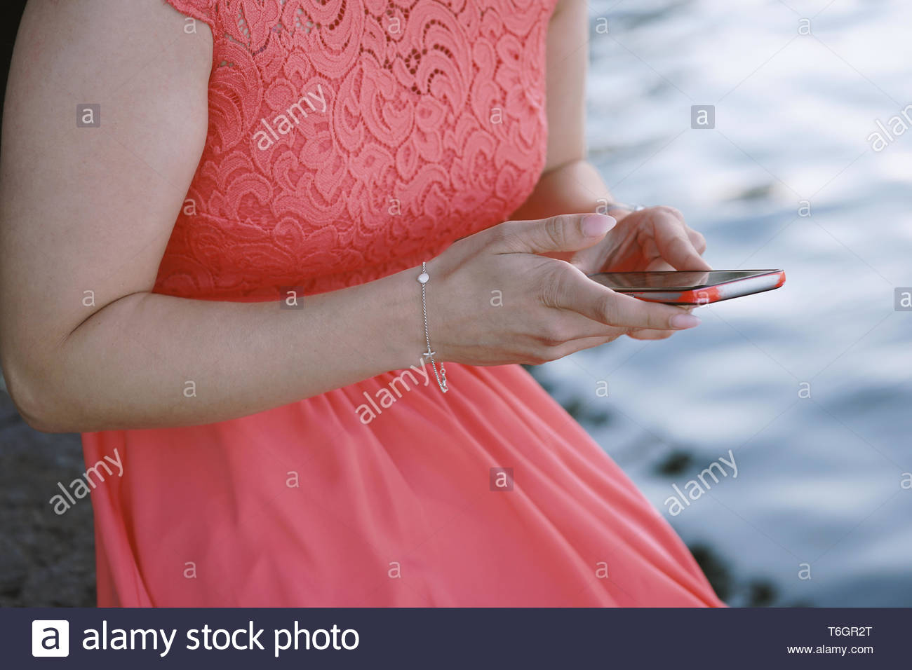 unrecognizable young woman using smartphone Stock Photo