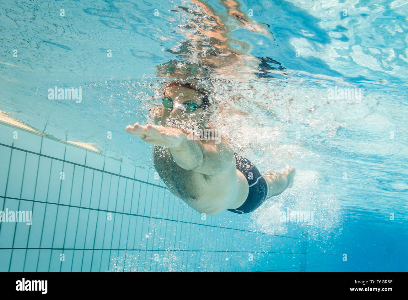 Male swimmer in the swimming pool.Underwater photo with copy space. Stock Photo