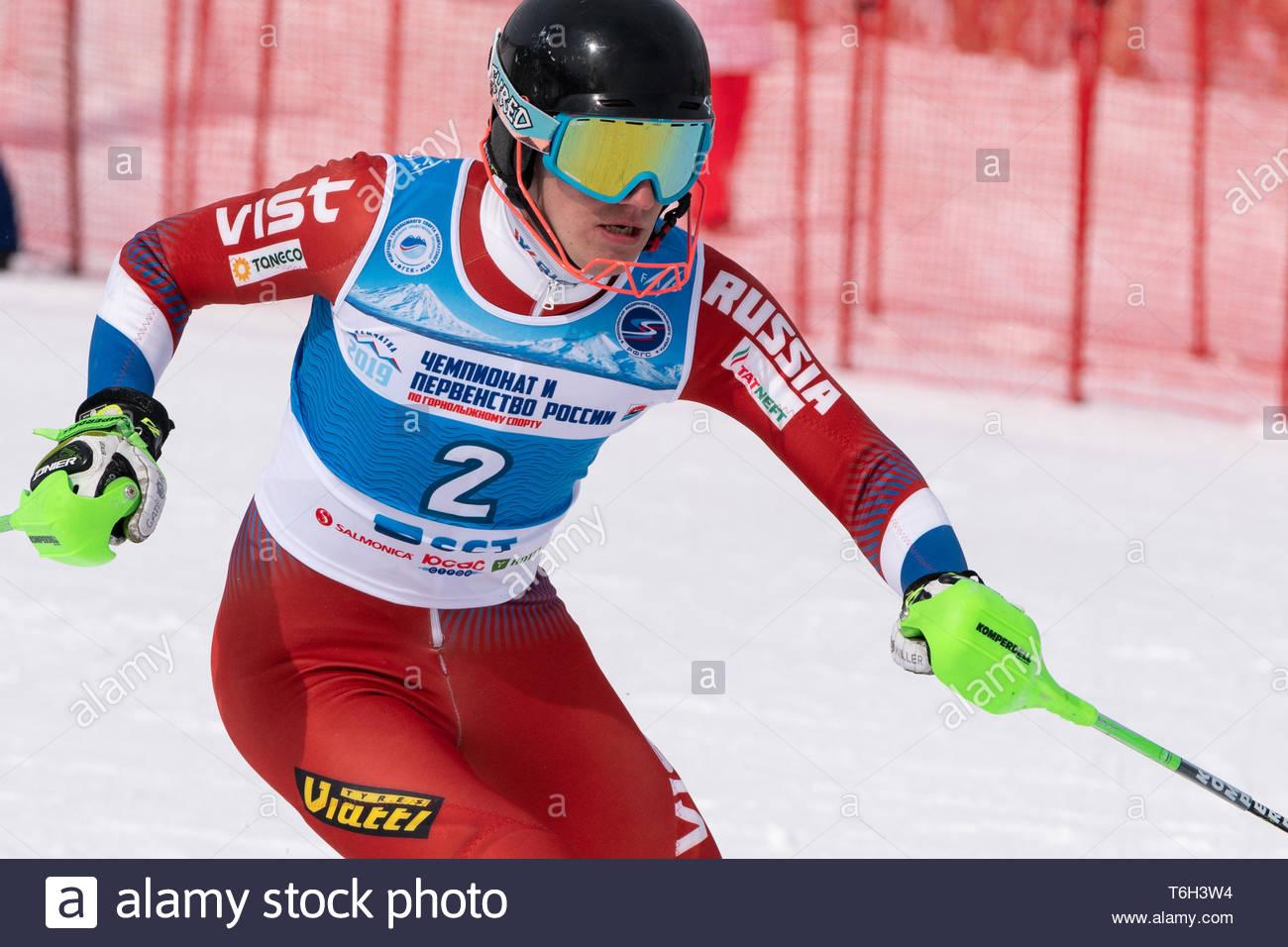 MOROZNAYA MOUNTAIN, KAMCHATKA, RUSSIA - MAR 28, 2019: Russian Alpine Skiing Cup, International Ski Federation Championship slalom. Skier Ovchinnikov A Stock Photo