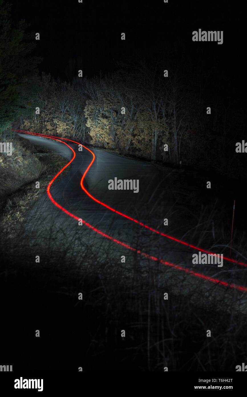 Light trail of a rally car at speed - Stock Image