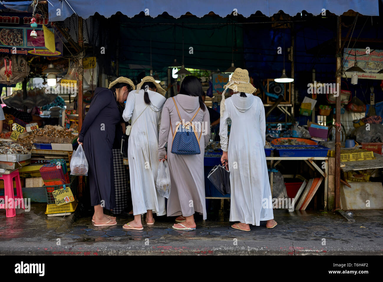 Chinese women shopping at a Thailand street food market - Stock Image