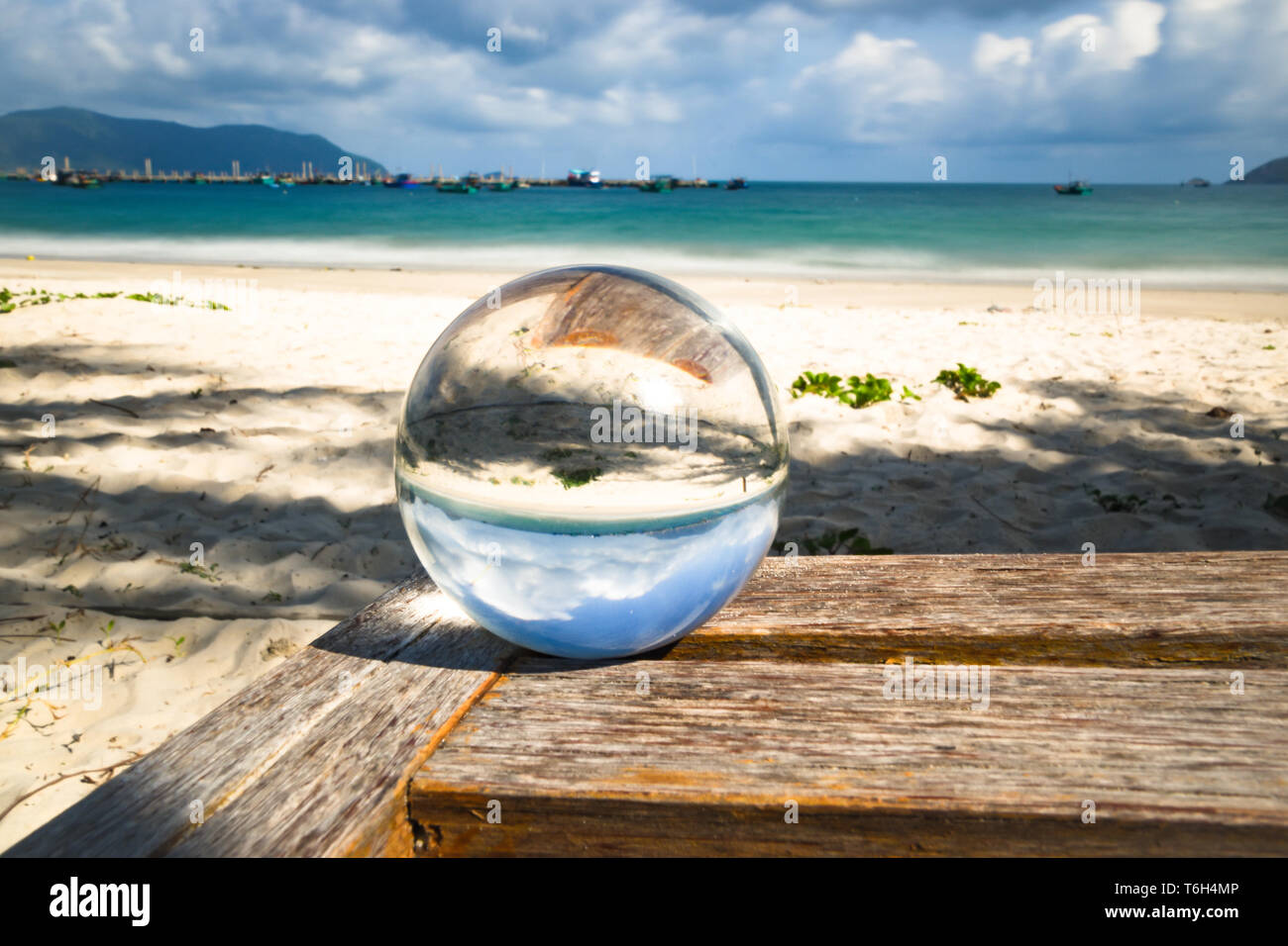 crystal ball and longtime exposure at the beach - Stock Image
