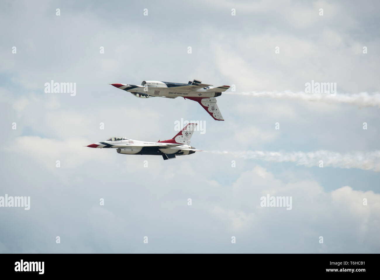 The Thunderbirds perform the Reflection Pass maneuver during the Wings Over Wayne Airshow, April 26, 2019, at Seymour Johnson Air Force Base, North Carolina. The Thunderbirds demonstrated the versatility of the F-16 Fighting Falcon by performing aerial acrobatics, precision formations and high-speed passes during their performance. (U.S. Air Force photo by Senior Airman Miranda A. Loera) - Stock Image