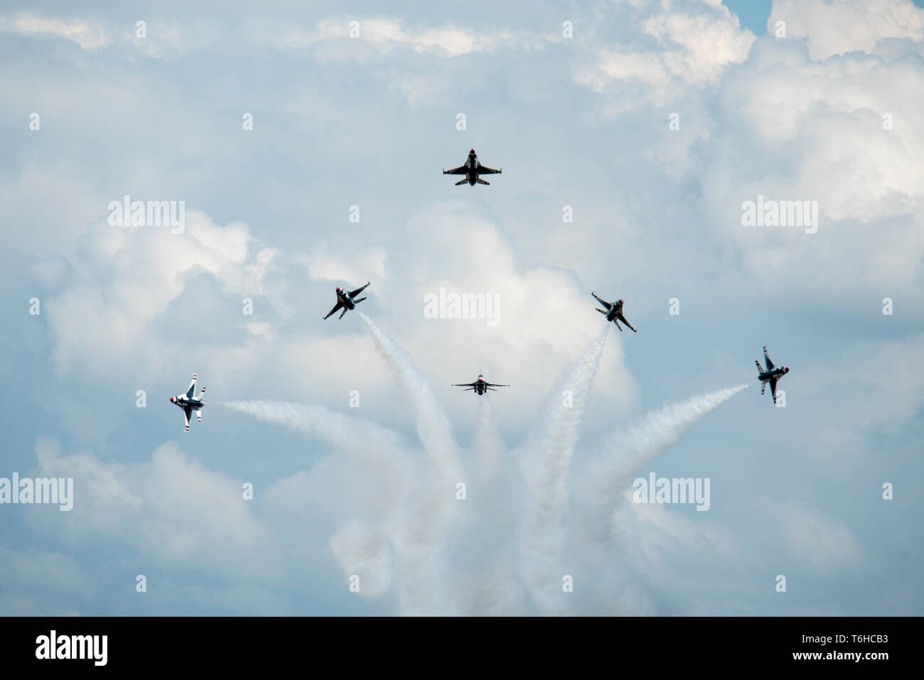 The Thunderbirds perform the Delta Burst maneuver during the Wings Over Wayne Airshow, April XX, 2019, at Seymour Johnson Air Force Base, North Carolina. The Thunderbirds demonstrated the versatility of the F-16 Fighting Falcon by performing aerial acrobatics, precision formations and high-speed passes during their performance. (U.S. Air Force photo by Senior Airman Miranda A. Loera) - Stock Image