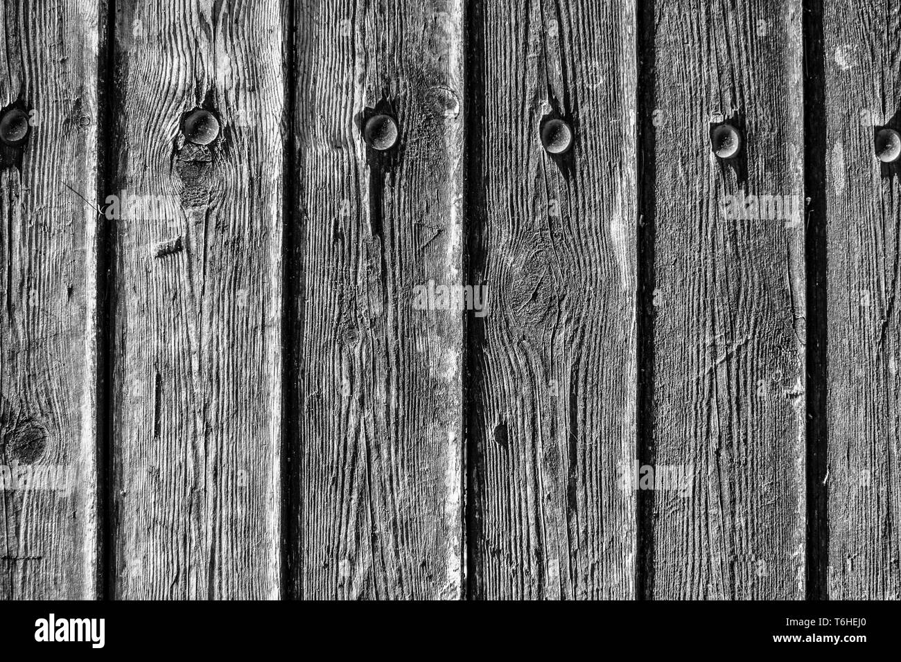 Weathered wood planks with metal nails textured background, black and white contrast - Stock Image