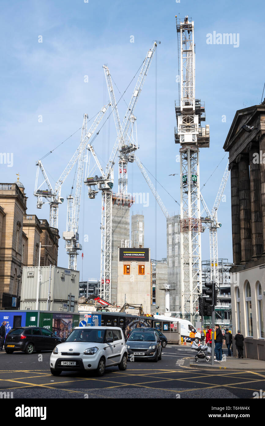 Tower cranes at construction site at St James Centre redevelopment viewed from top of Leith Street in Edinburgh, Scotland, UK - Stock Image