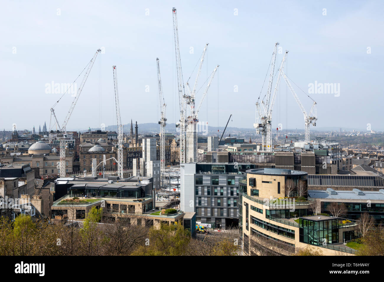 Tower cranes at construction site at St James Centre redevelopment viewed from Calton Hill in Edinburgh, Scotland, UK - Stock Image