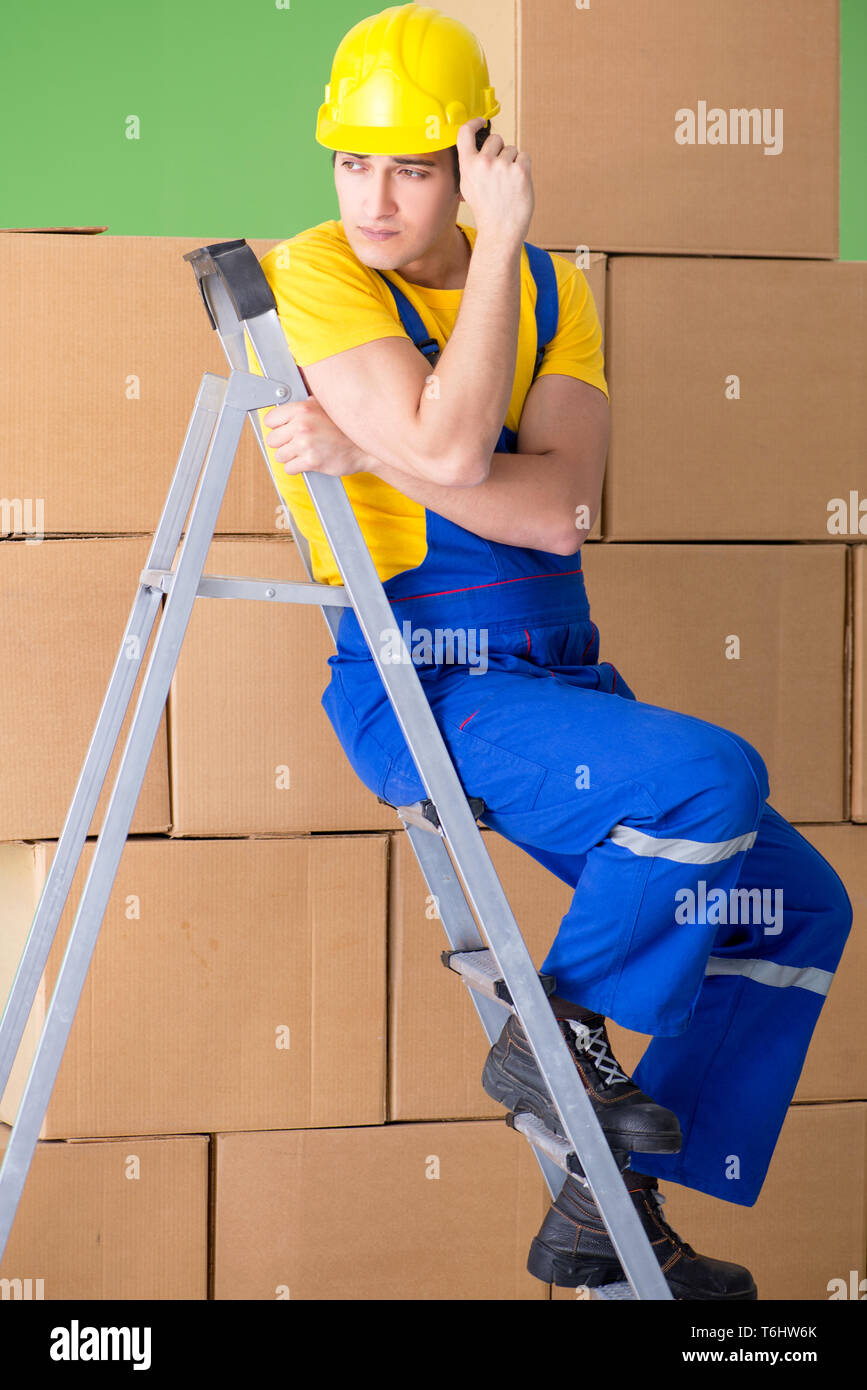 Man contractor working with boxes delivery - Stock Image