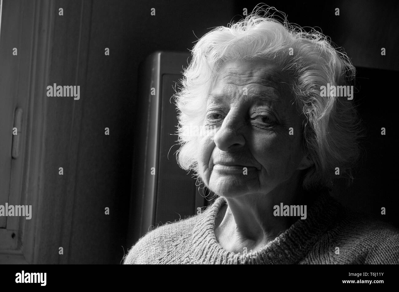 Portrait of old woman looking at the camera. Close view. - Stock Image