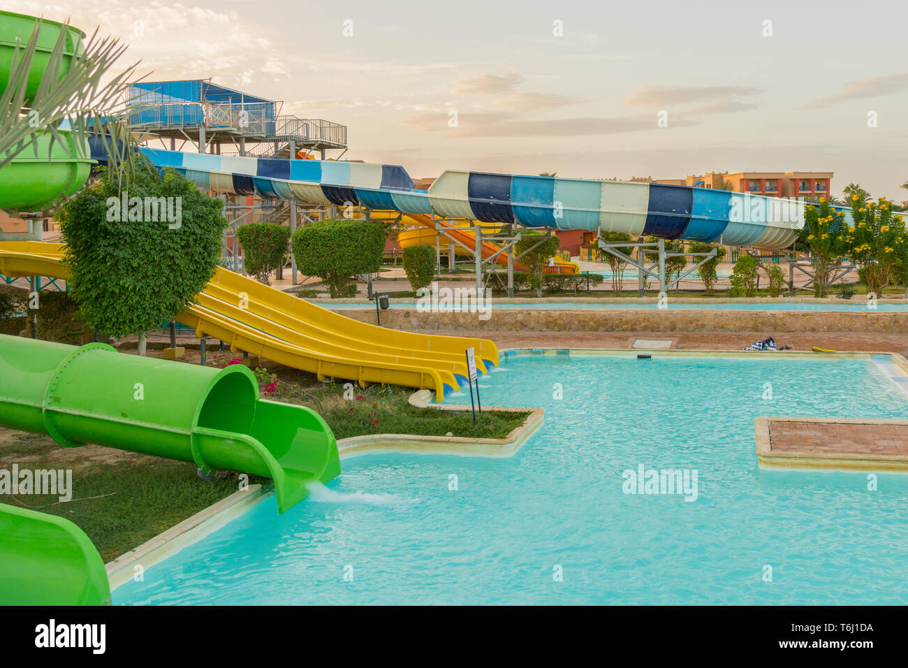 Colourful Plastic Slides In Aquapark In The Sunset Sliders