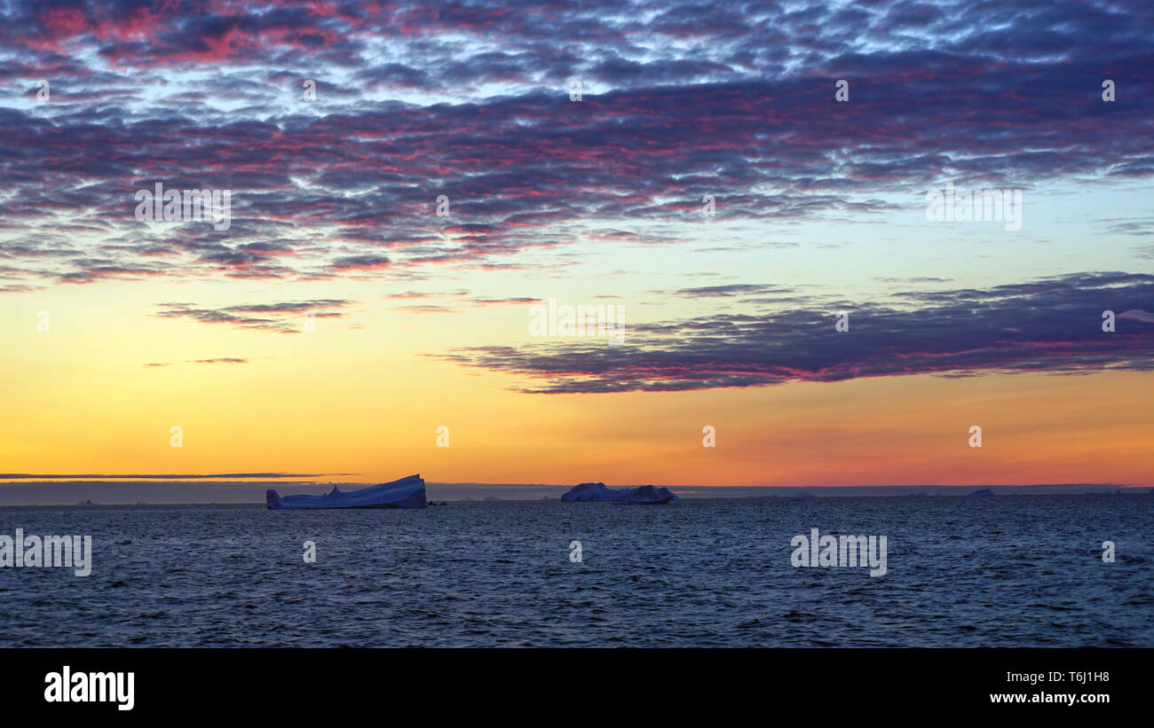 Sunset off the West Coast of Greenland in the Davis Strait Stock Photo