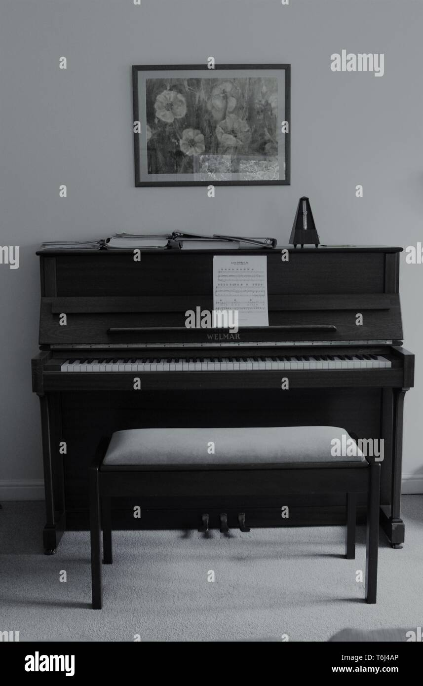 Piano in a living room - Stock Image