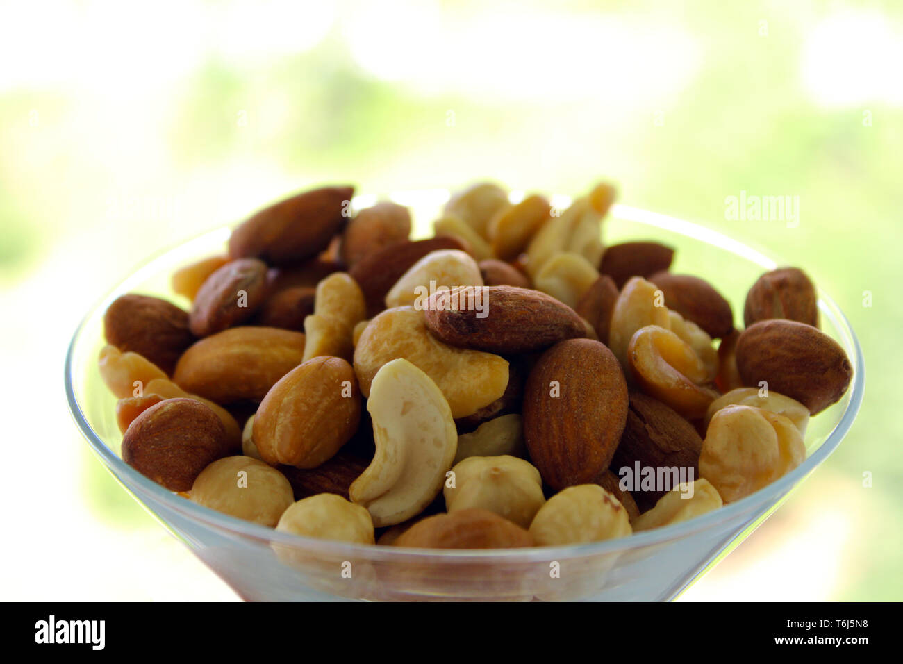 Mixed nuts in the bowl - Stock Image