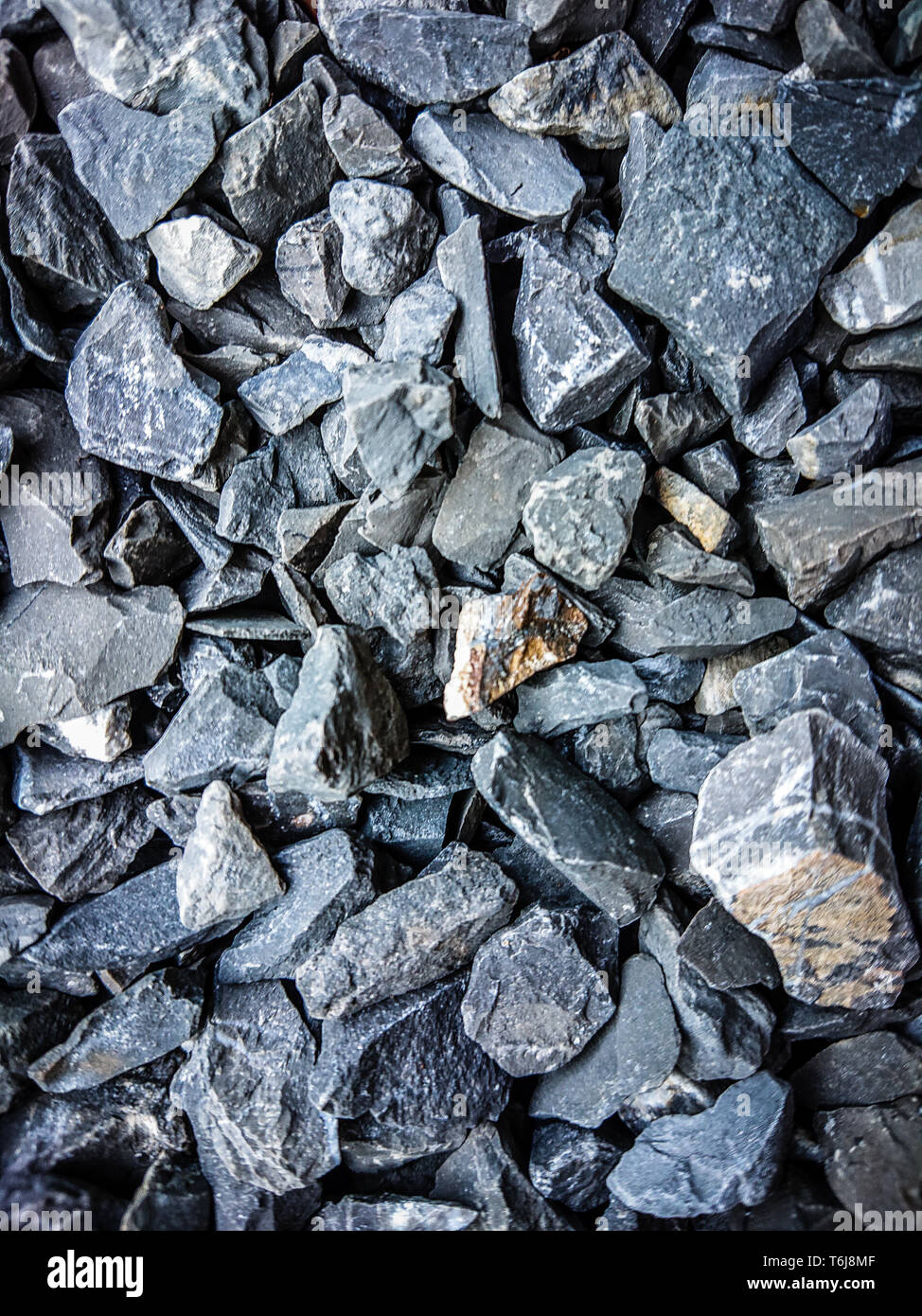 Rock surface texture background.Stone material pattern.Old gray rock on ground - Stock Image