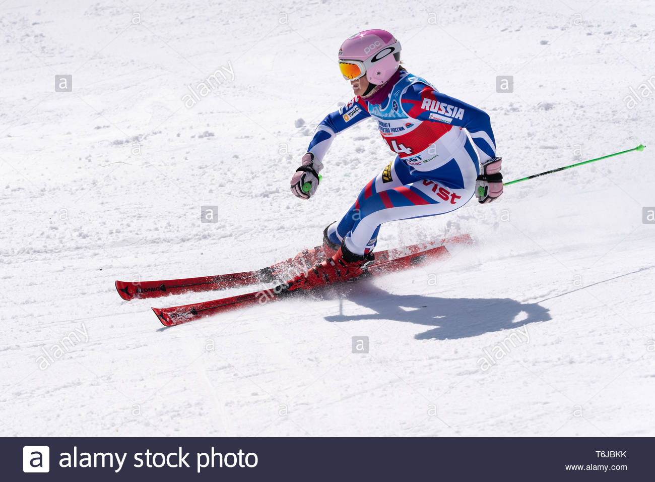 KAMCHATKA PENINSULA, RUSSIAN FEDERATION - APRIL 1, 2019: Mountain skier Vitalina Girina (Moscow Region) skiing down snowy mountain slope. Russian Wome - Stock Image