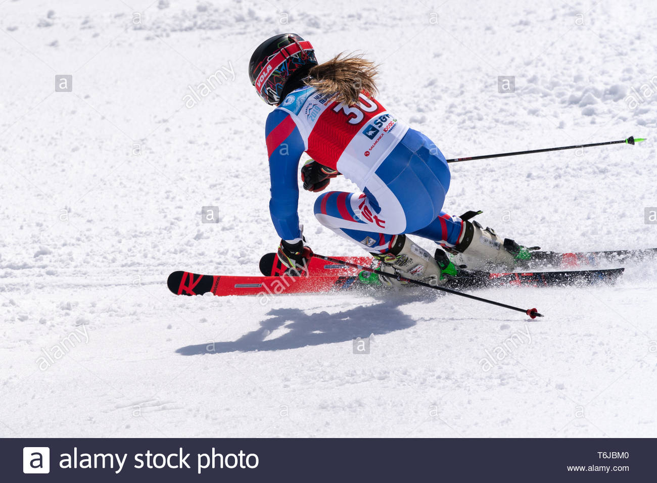 KAMCHATKA PENINSULA, RUSSIAN FEDERATION - APRIL 1, 2019: Mountain skier Lendya Ulyana (Kamchatka Territory) skiing down snowy mountain slope. Russian  - Stock Image