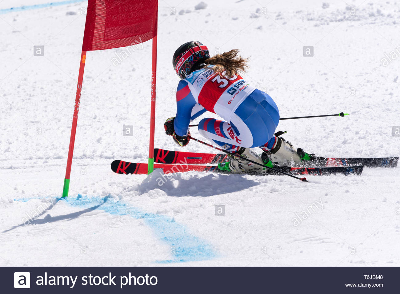 KAMCHATKA PENINSULA, RUSSIAN FEDERATION - APRIL 1, 2019: Russian Women's Alpine Skiing Championship, giant slalom. Mountain skier Ulyana Lendya (Kamch - Stock Image
