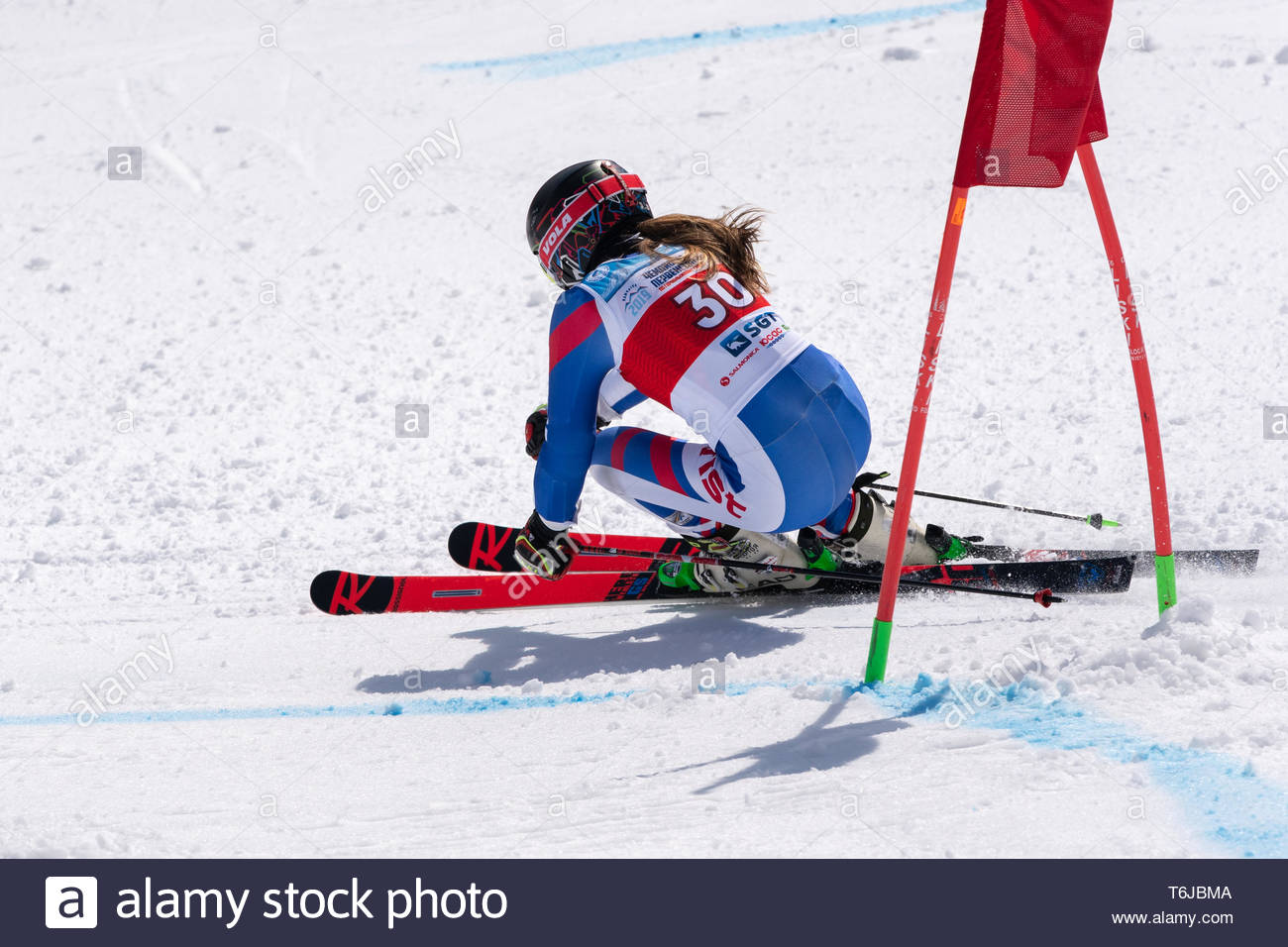 KAMCHATKA PENINSULA, RUSSIAN FEDERATION - APRIL 1, 2019: Mountain skier Ulyana Lendya (Kamchatka Region) skiing down snowy mountain slope. Russian Wom - Stock Image