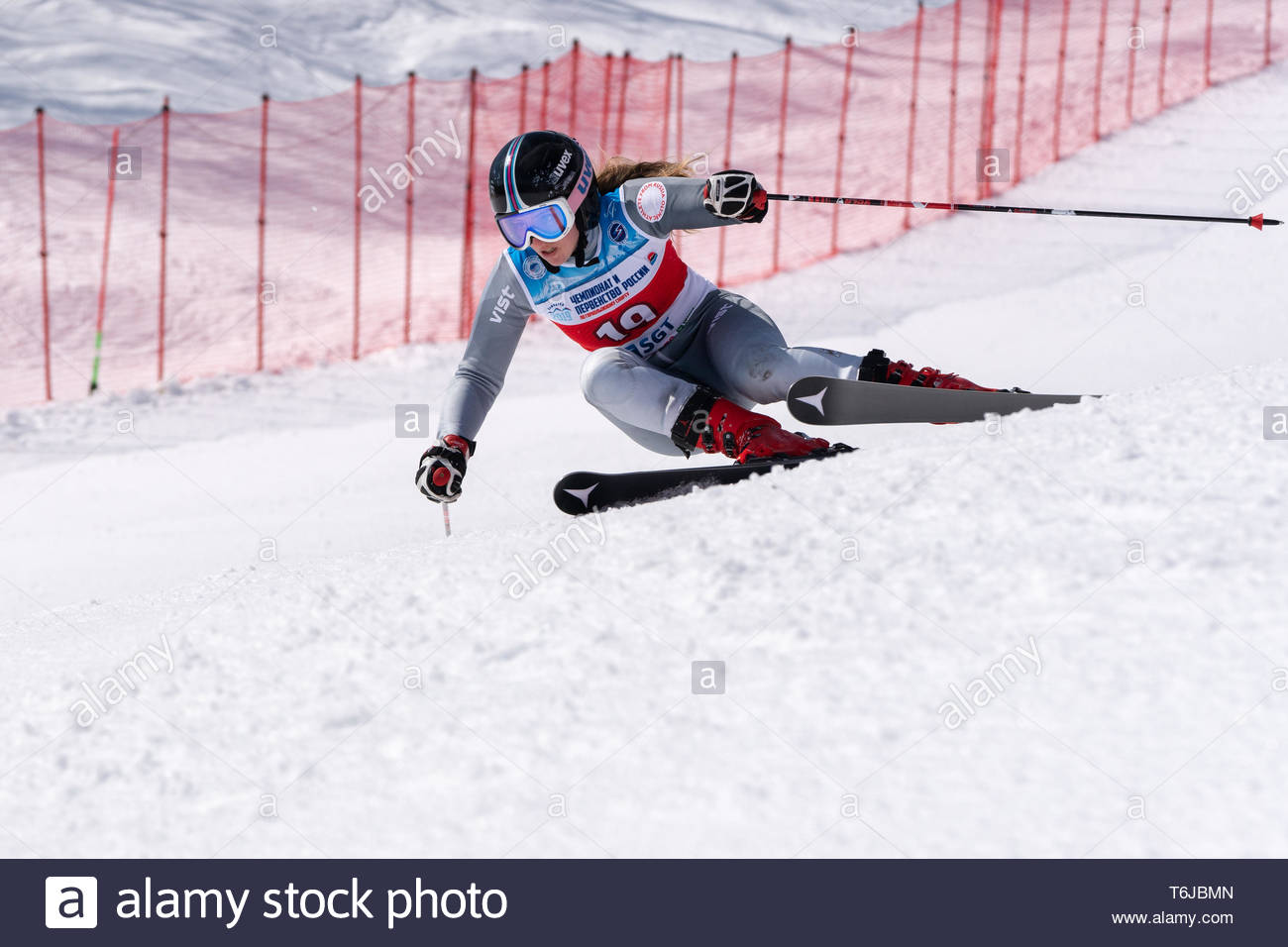 KAMCHATKA PENINSULA, RUSSIAN FEDERATION - APRIL 1, 2019: Mountain skier Fokina Milena (Kamchatka Region) skiing down snowy mountain slope. Russian Wom - Stock Image
